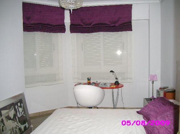 dormitorio con dobles estores