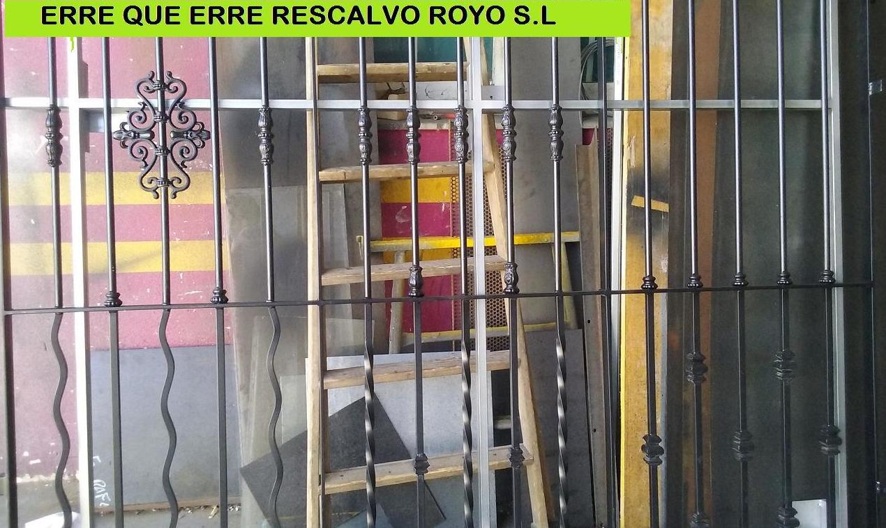 FABRICACION DE REJA CON VARIOS MODELOS DE BARROTES Y DECORACION PARA LA EXPOSICION