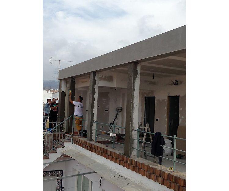 Construcción de planta sobre casa