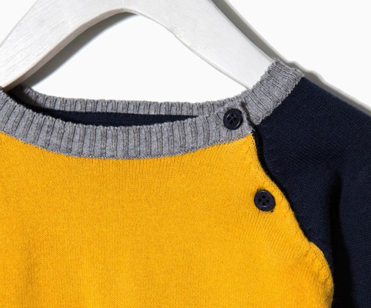Detalle jersey punto amarillo mangas azul antes 12.99 € ahora 9.10€