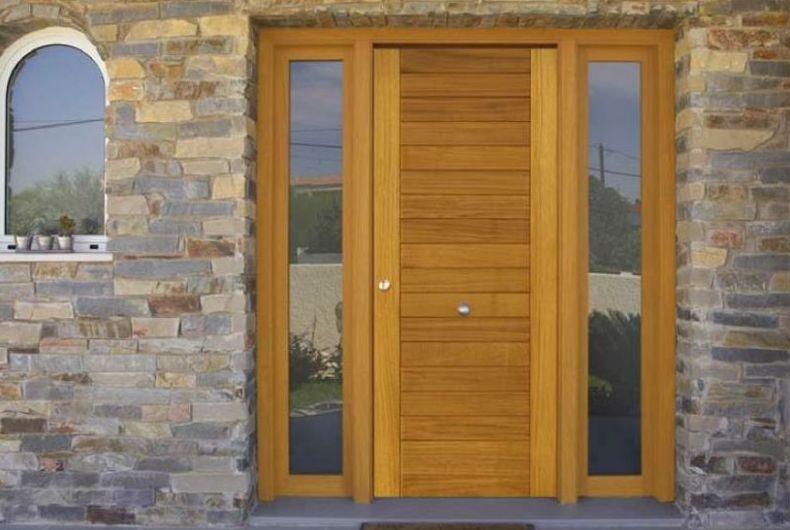 Puertas de madera para interiores en horta guinard for Puertas macizas exterior