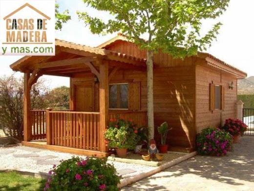 Casas de madera productos de puertas miret for Puertas de madera prefabricadas guatemala