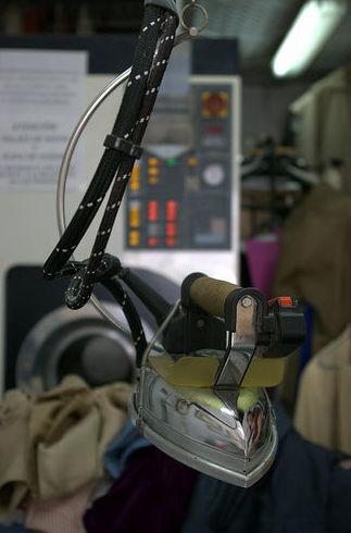 Enmidonat : Servicios  de Tintoreria Cel Obert