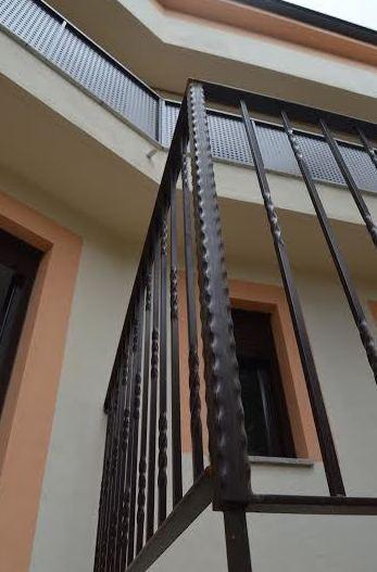 Detalle de barandilla exterior de forja