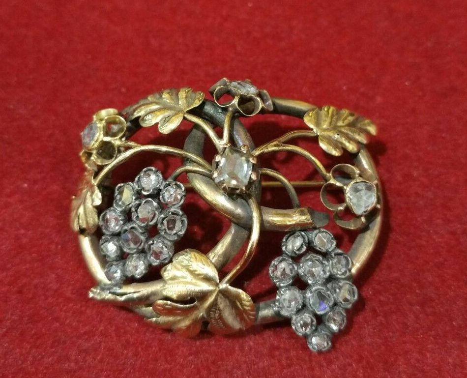 Broche con parra y uvas en oro amarillo de 18k con diamantes. S. XIX: Catálogo de Antigua Joyeros