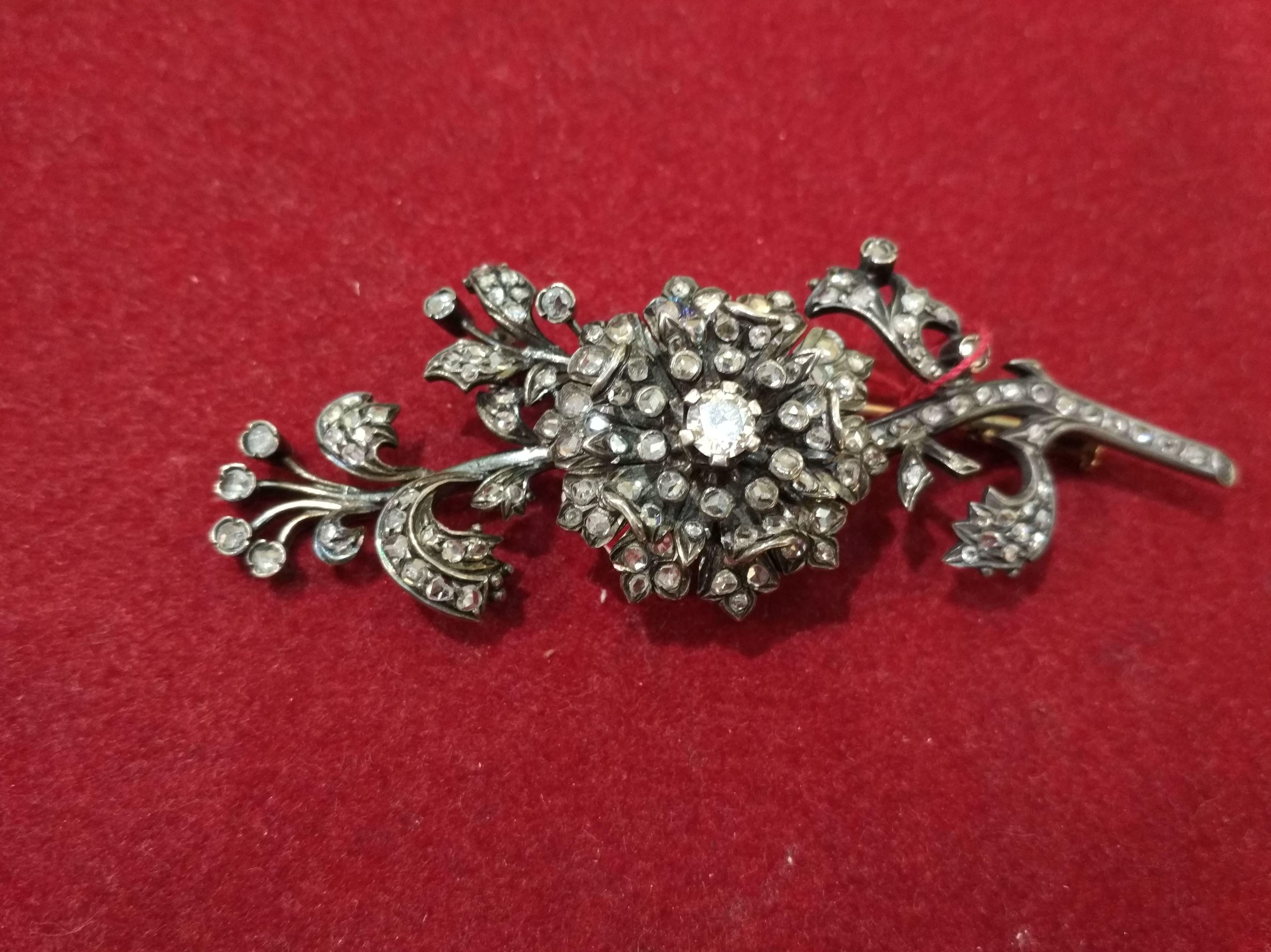 Broche floral de oro de 18k, vistas en plata y diamantes. S.XIX: Catálogo de Antigua Joyeros