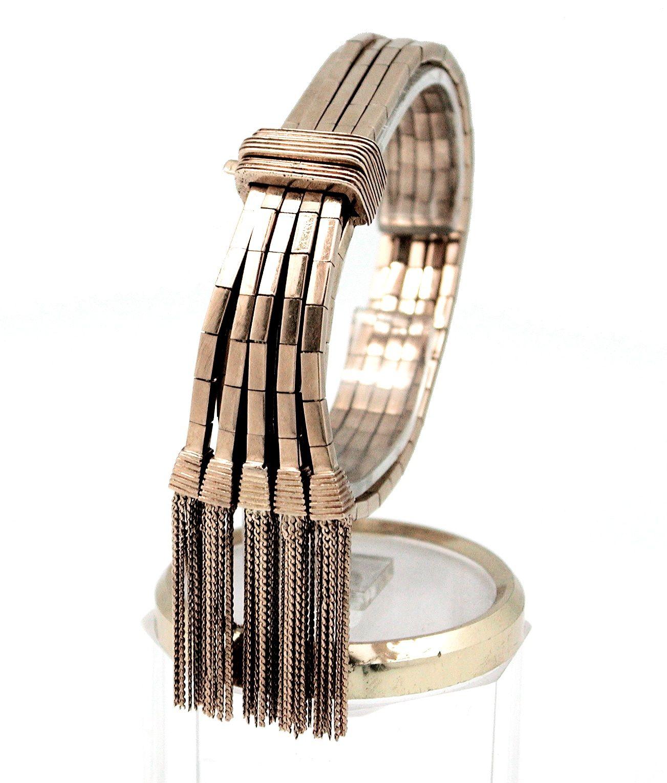 Pulsera articulada con flecos de oro 18 qtes.
