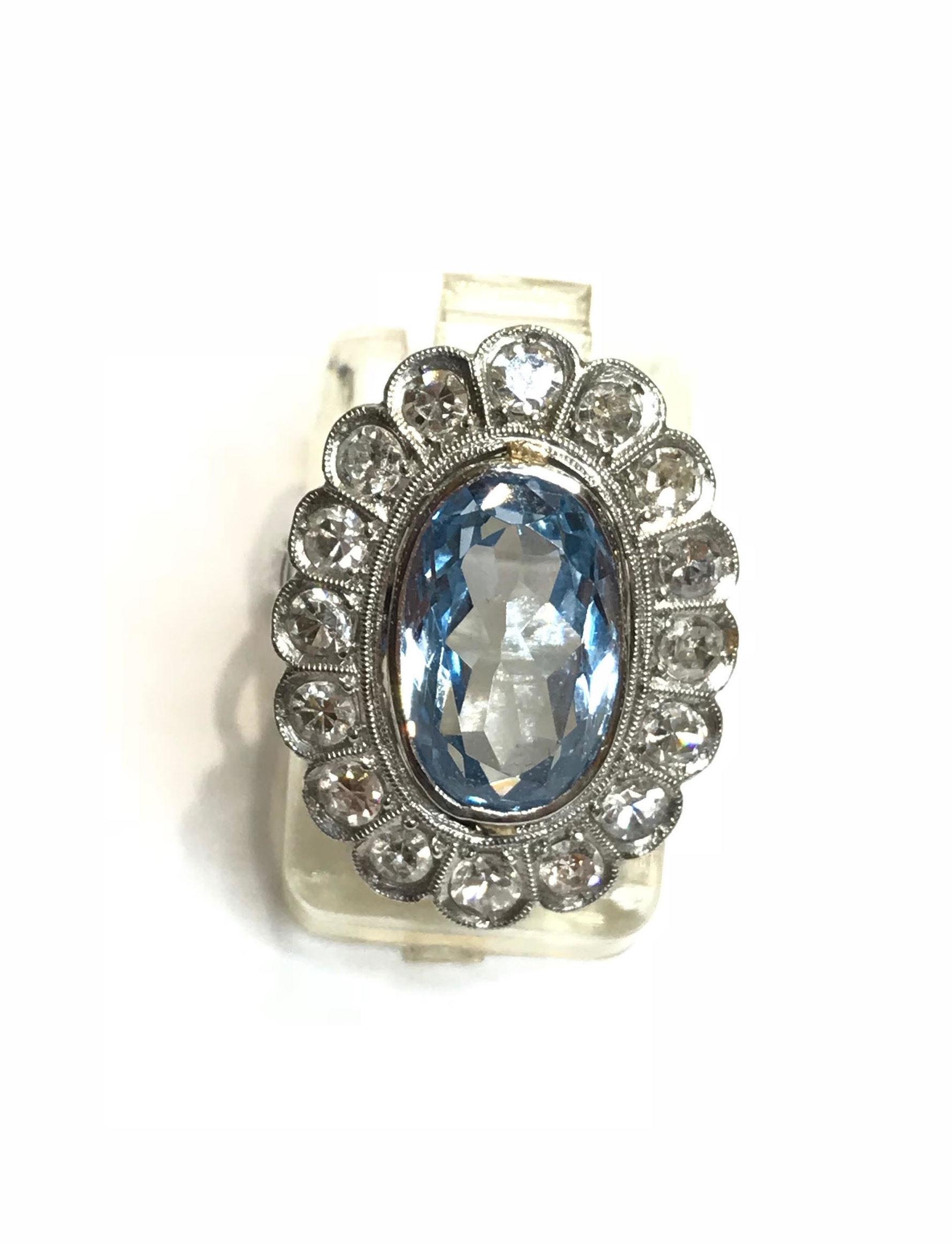 Sortija Sra. topacio azul y brillantes montada en platino.: Catálogo de Antigua Joyeros