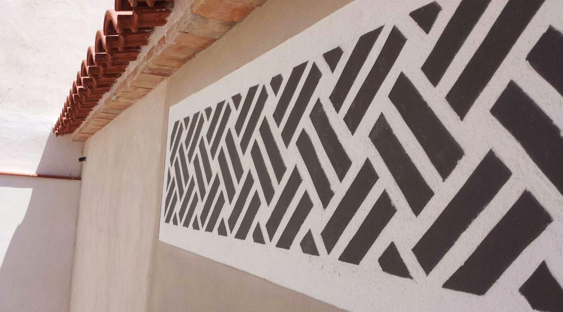 Esgrafiados en fachada en Cieza