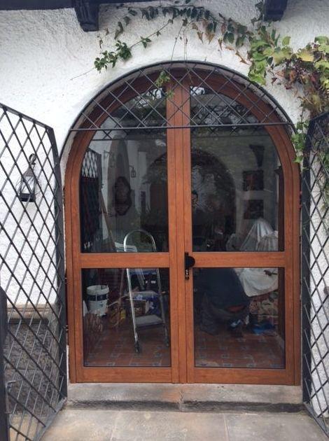 Puerta dos hojas medio punto
