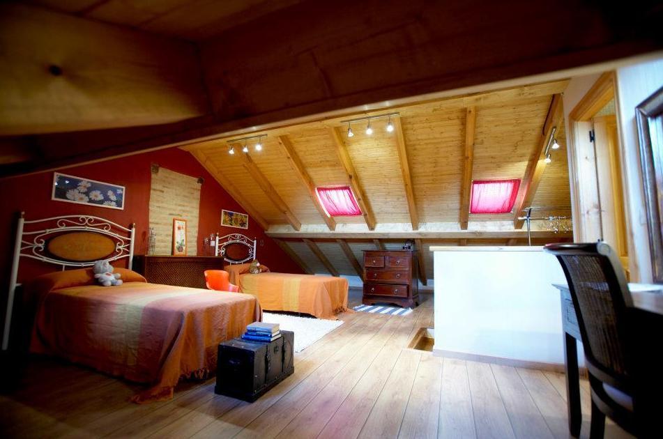 Habitación de dos camas en el último piso