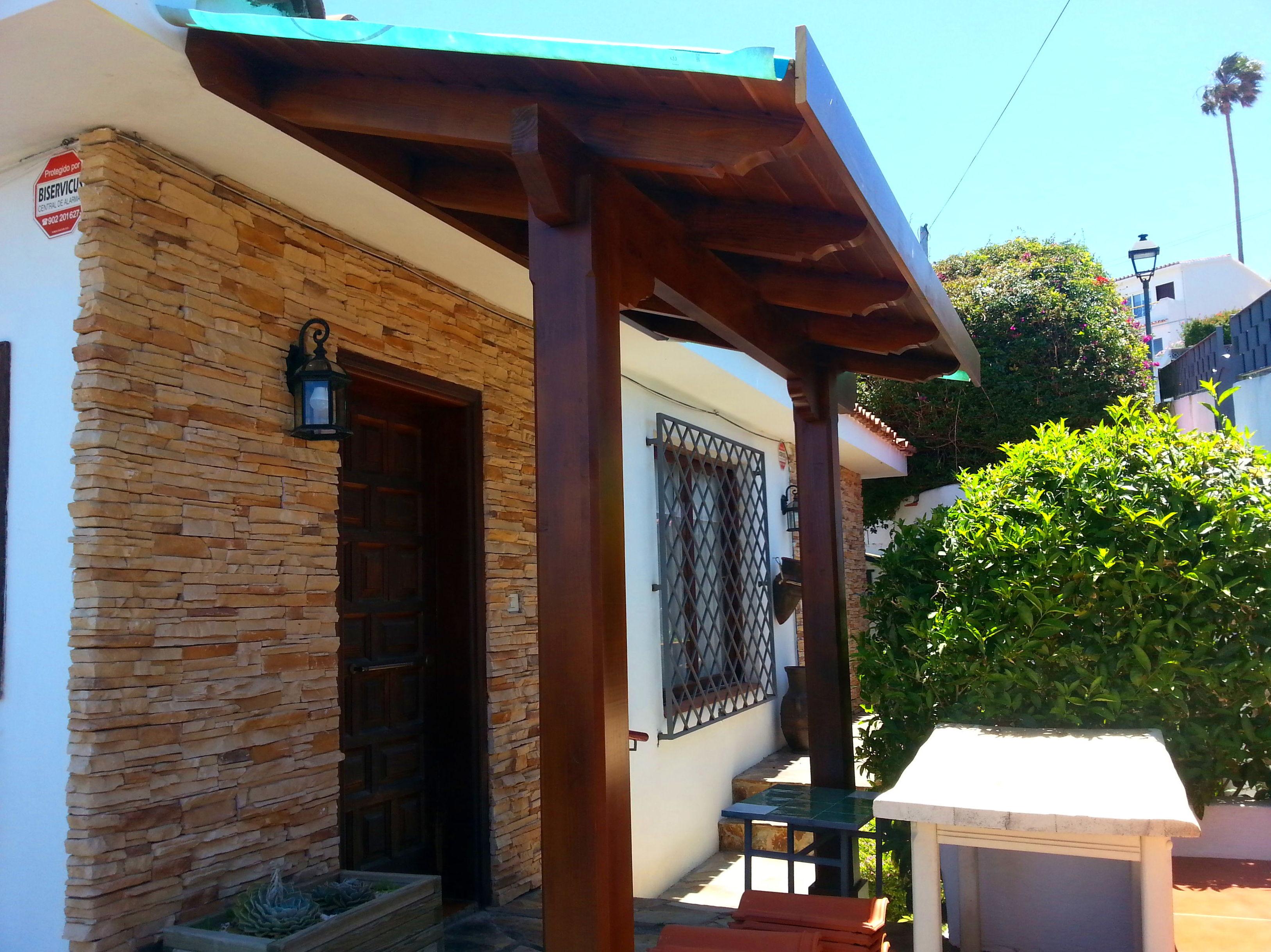 Marquesina Madera cubre puerta
