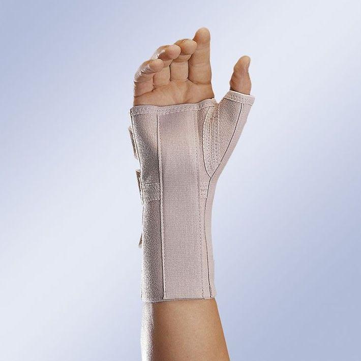 Muñequera elástica abierta larga con férula palmar y pulgar: Productos y servicios de Ortopedia Delgado, S. L.
