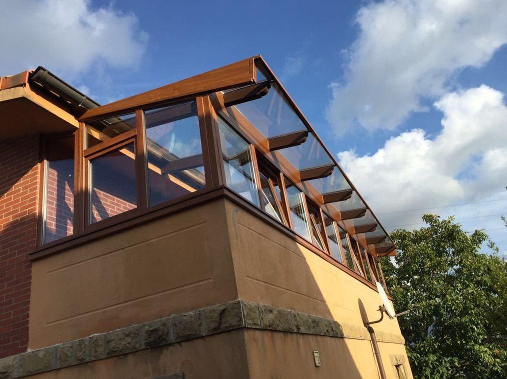 Cerramiento de porche con tejado en Guarnizo