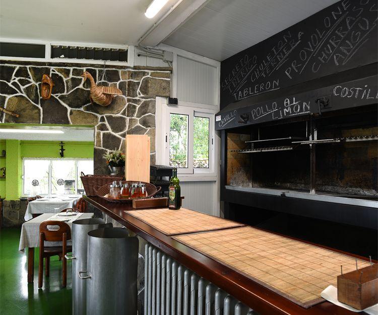 Platos tradicionales de la  gastronomía asturiana en el restaurante El Titi