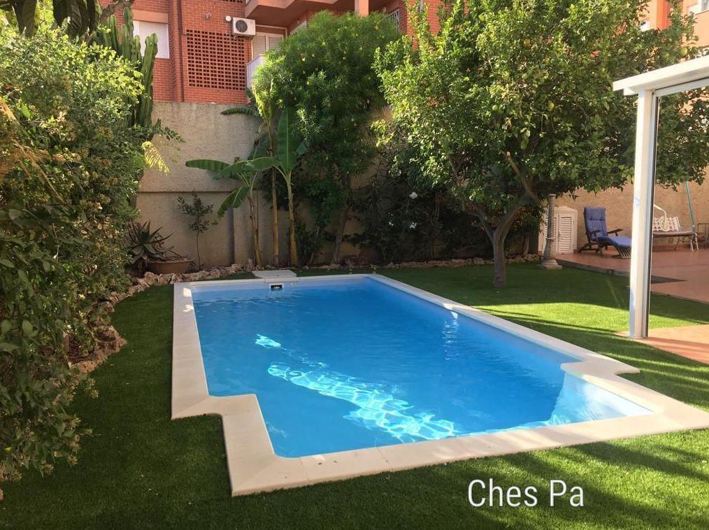 Proyecto integral paissjismo con piscina, césped artificial en Valencia