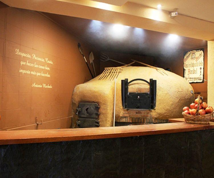 Asador con horno de leña en Segovia