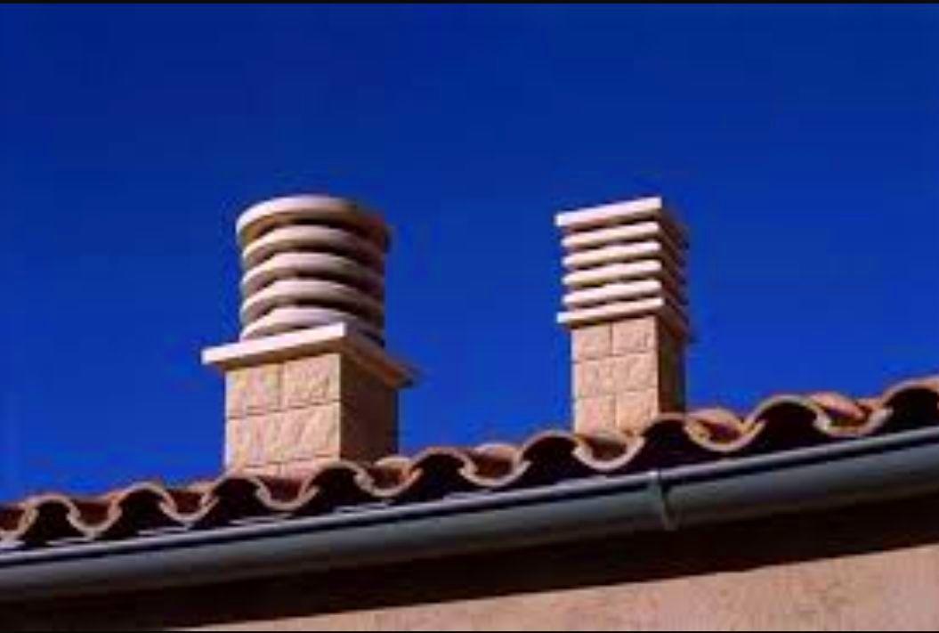 Canalón redondo color pizarra y revestimiento de chimeneas