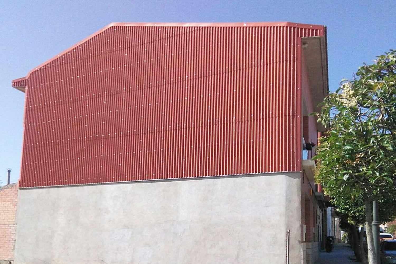 Tabique pluvial ondulado en fachada