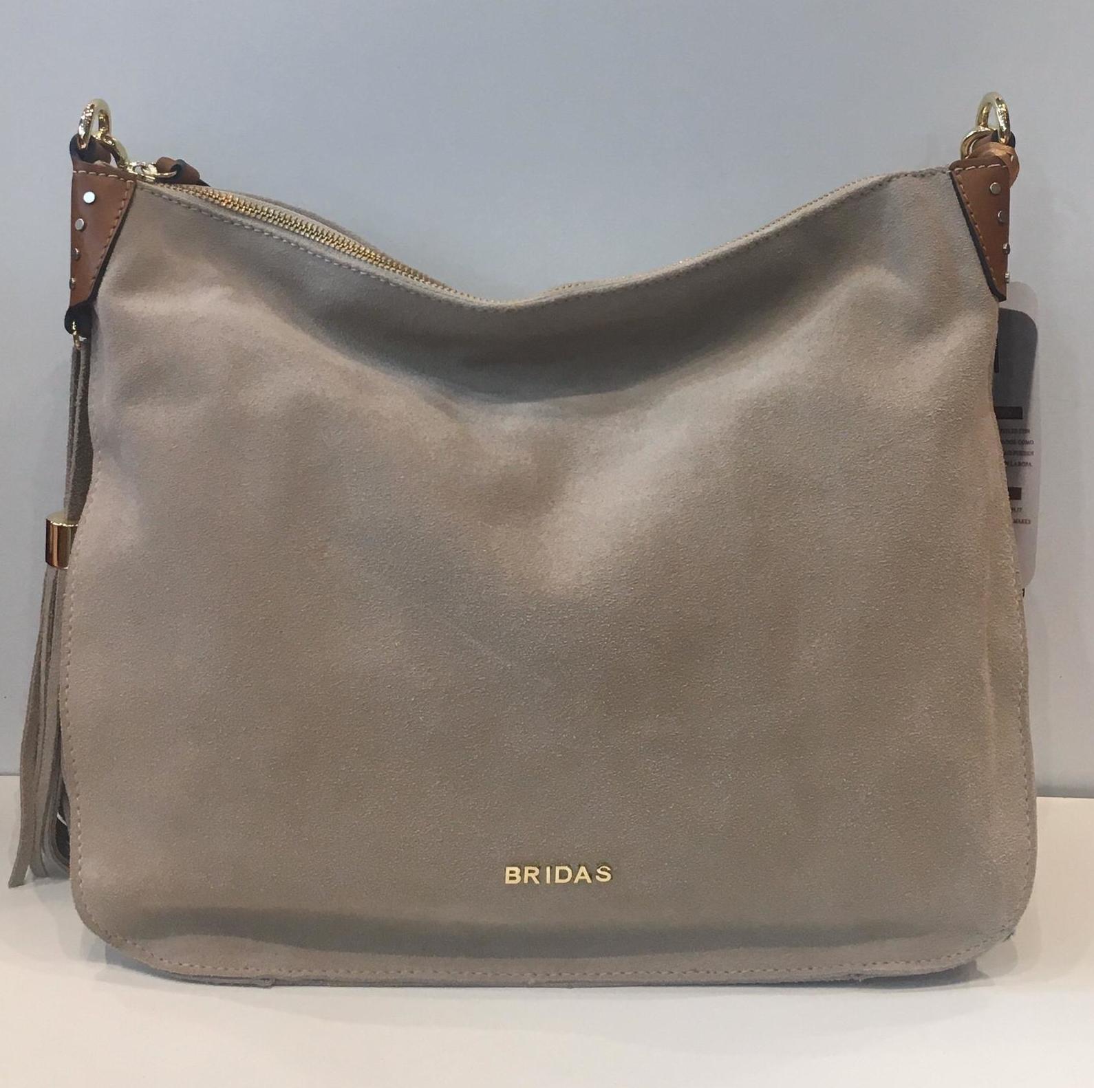 Bossa de pell de la marca Bridas, amb tira llarga i curta 129.50€ — a La Bisbal.