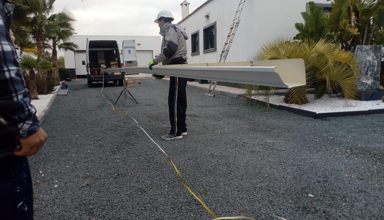 Instalación de Canalon de aluminio en blanco