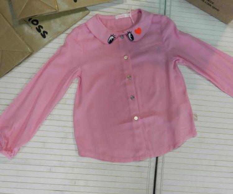Camisa rosa con ojitos