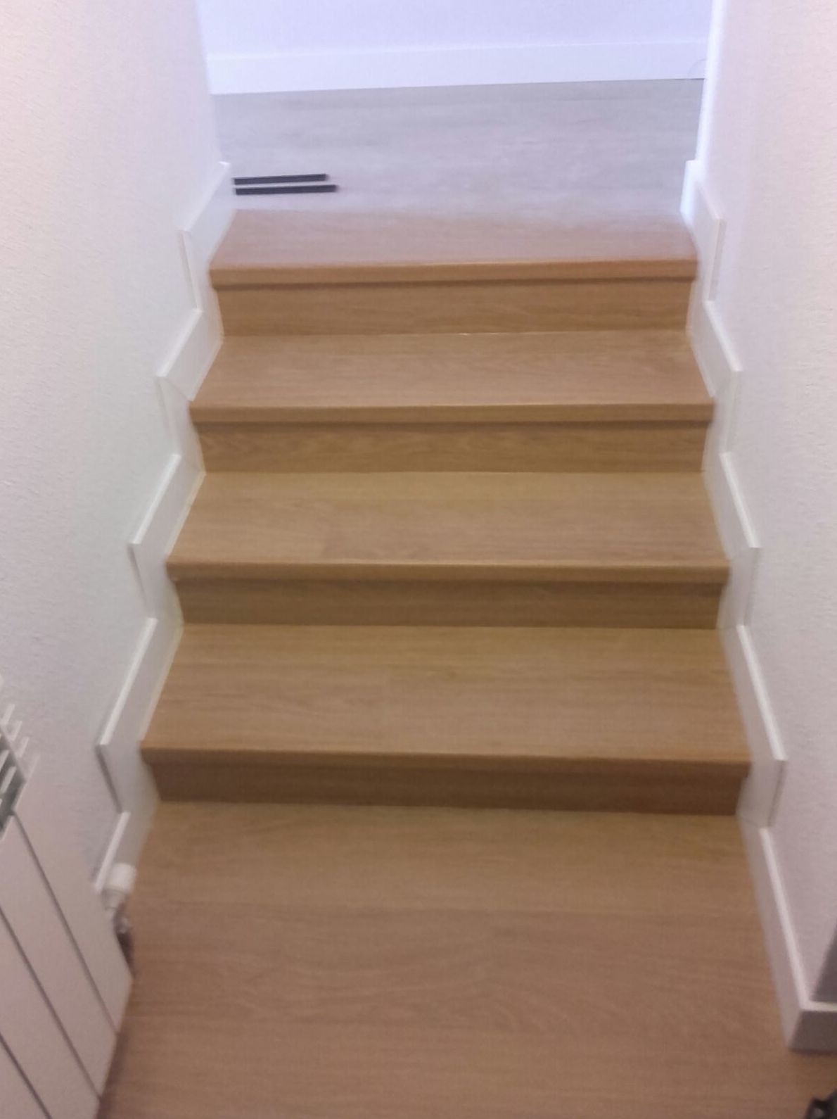 Quick-Step serie Impressive 8mm. modelo Roble Barnizado Natural en Planchas.