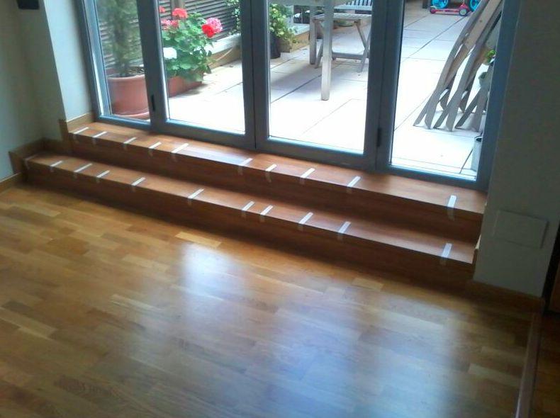 Creación de 2 peldaños para acceso a terraza con Laminado de Quic-Step serie Eligna.