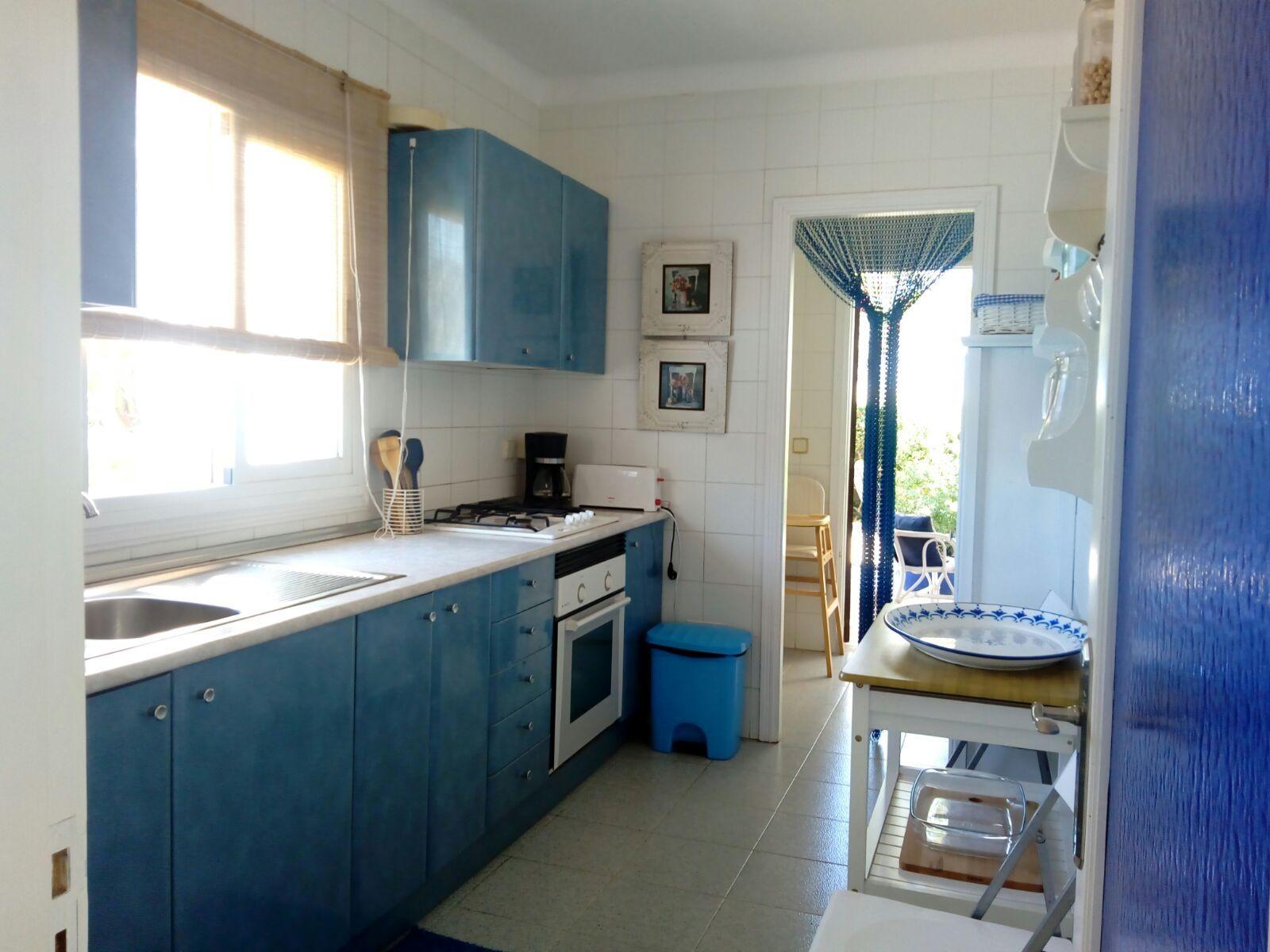 Cocina con salida a terraza Villa I
