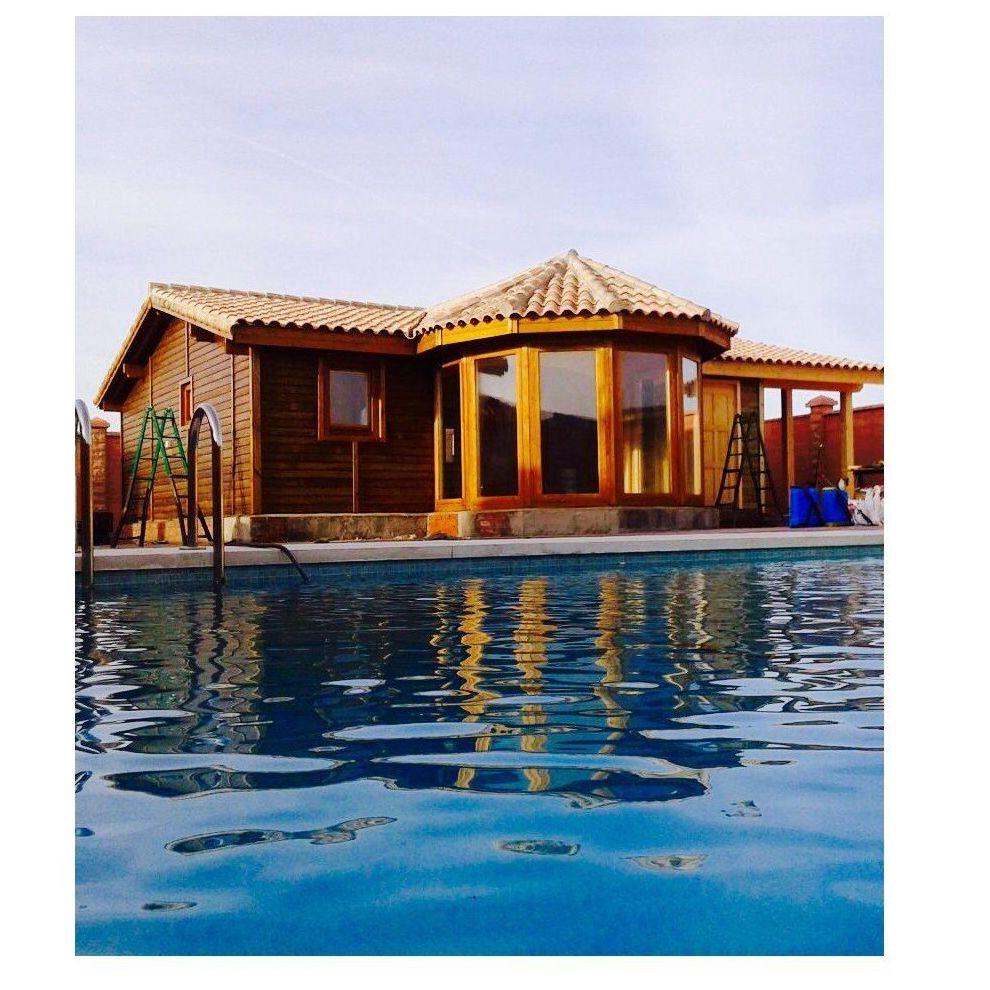 Daniela Exposición (101 m2): Casas de madera de 5SCC Casas de Madera