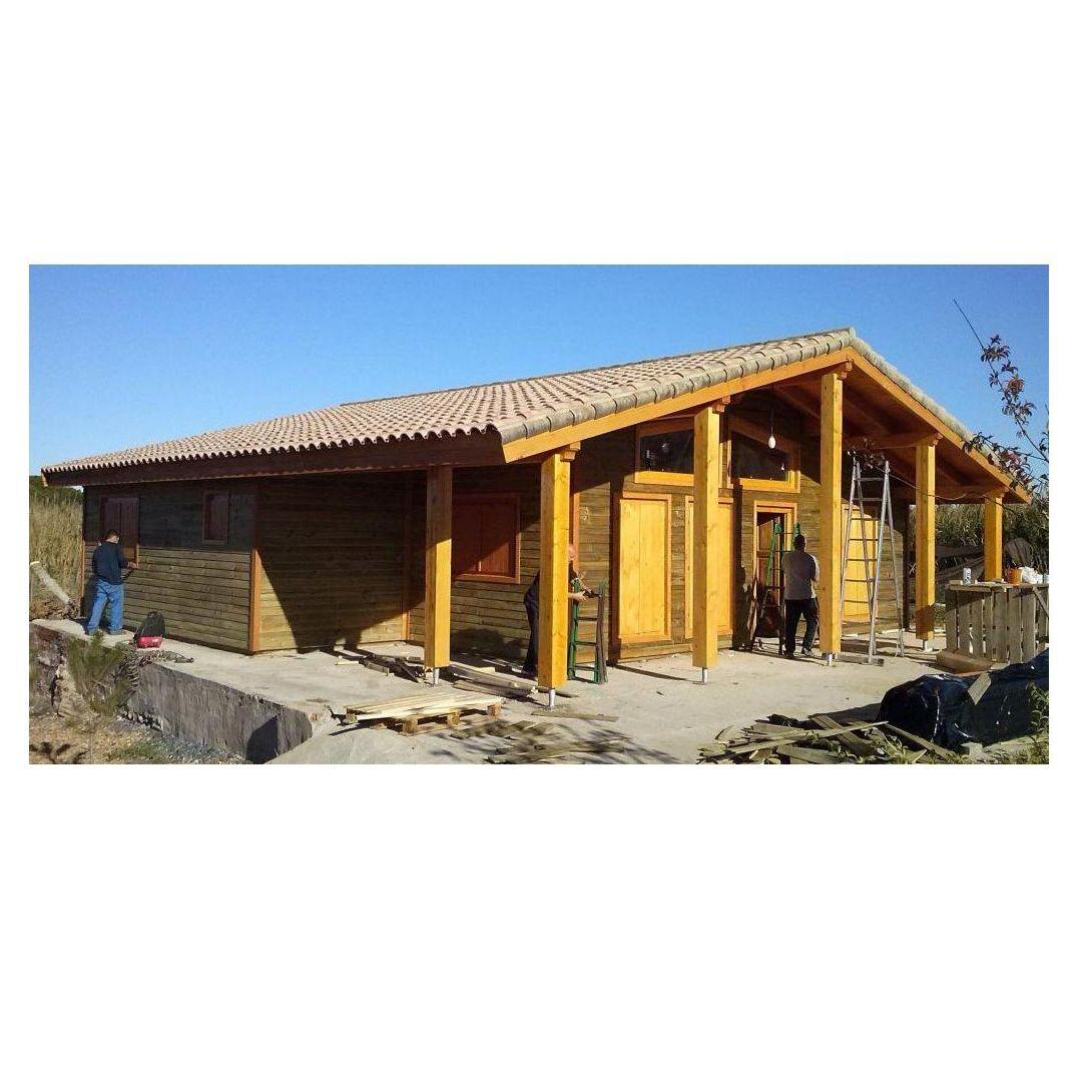 Ermine Huelva (119 m2): Casas de madera de 5SCC Casas de Madera