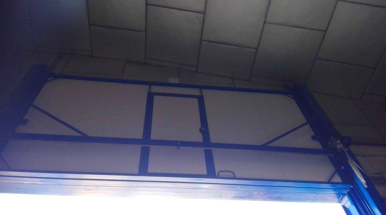 Puerta automática de guillotina industrial 2 hojas de panel