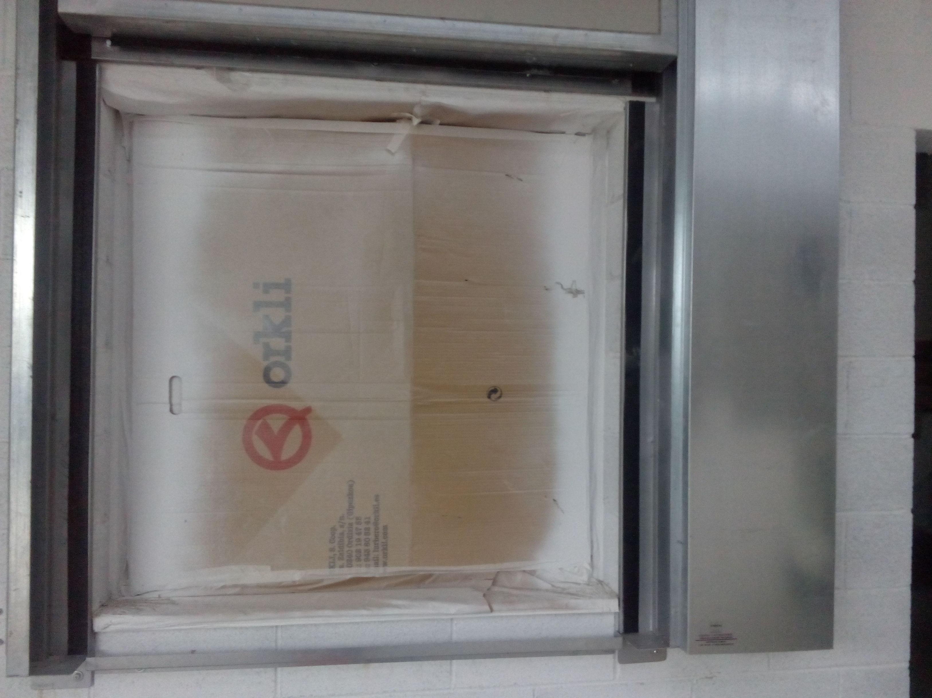 Puerta cortafuegos guillotina vertical , junta intumescente, resistencia al fuego 90 minutos