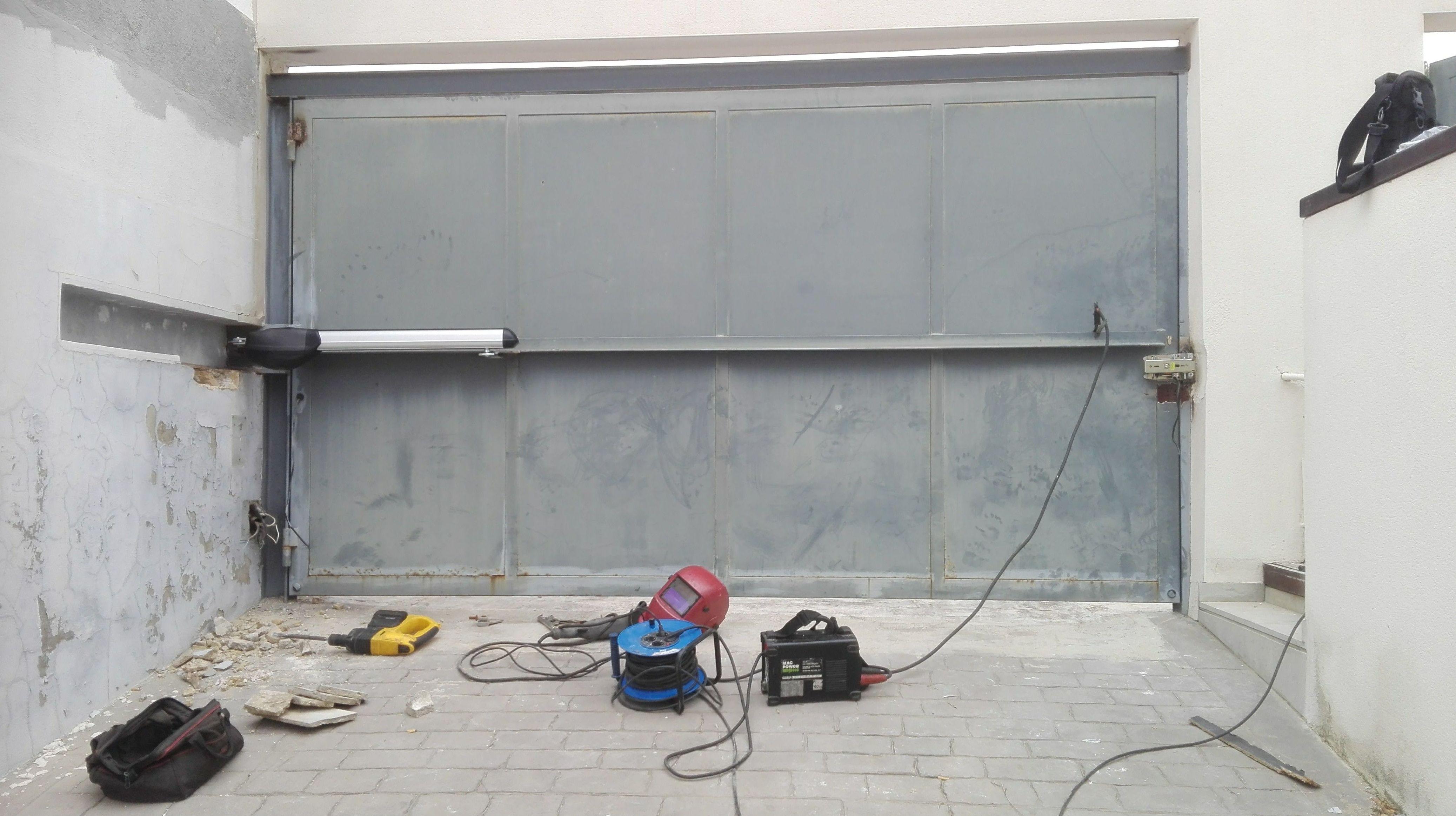 automatización de puerta batiente residencial en torrent motor electromecánico largo lento