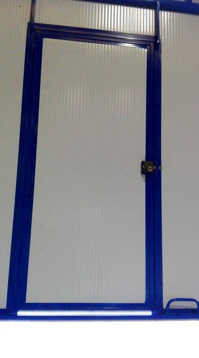 Puerta peatonal en guillotina industrial 2 hojas de panel