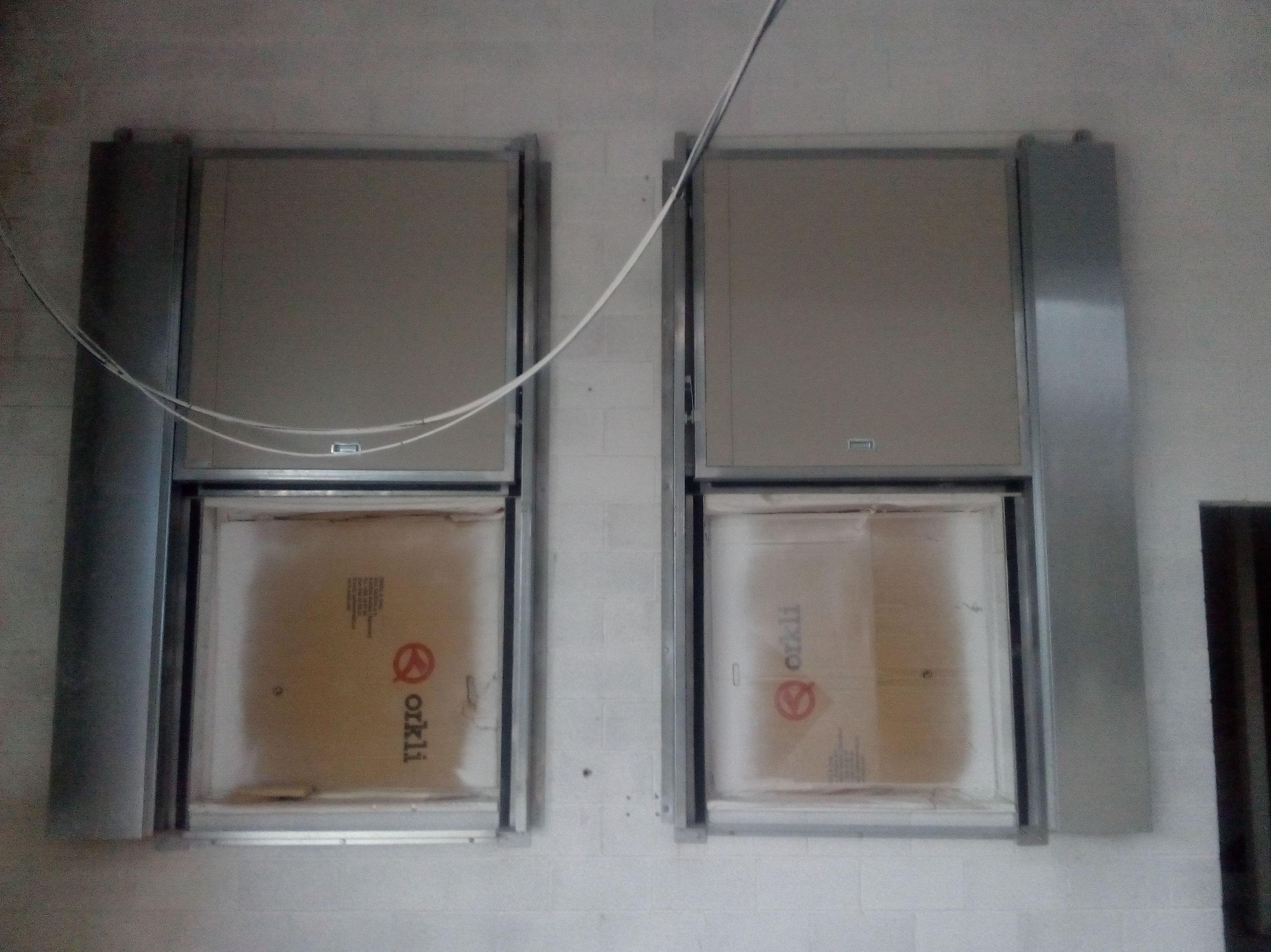 Puertas cortafuegos guillotinas verticales contrapesos laterales, certificadas , cierre por fusible térmico
