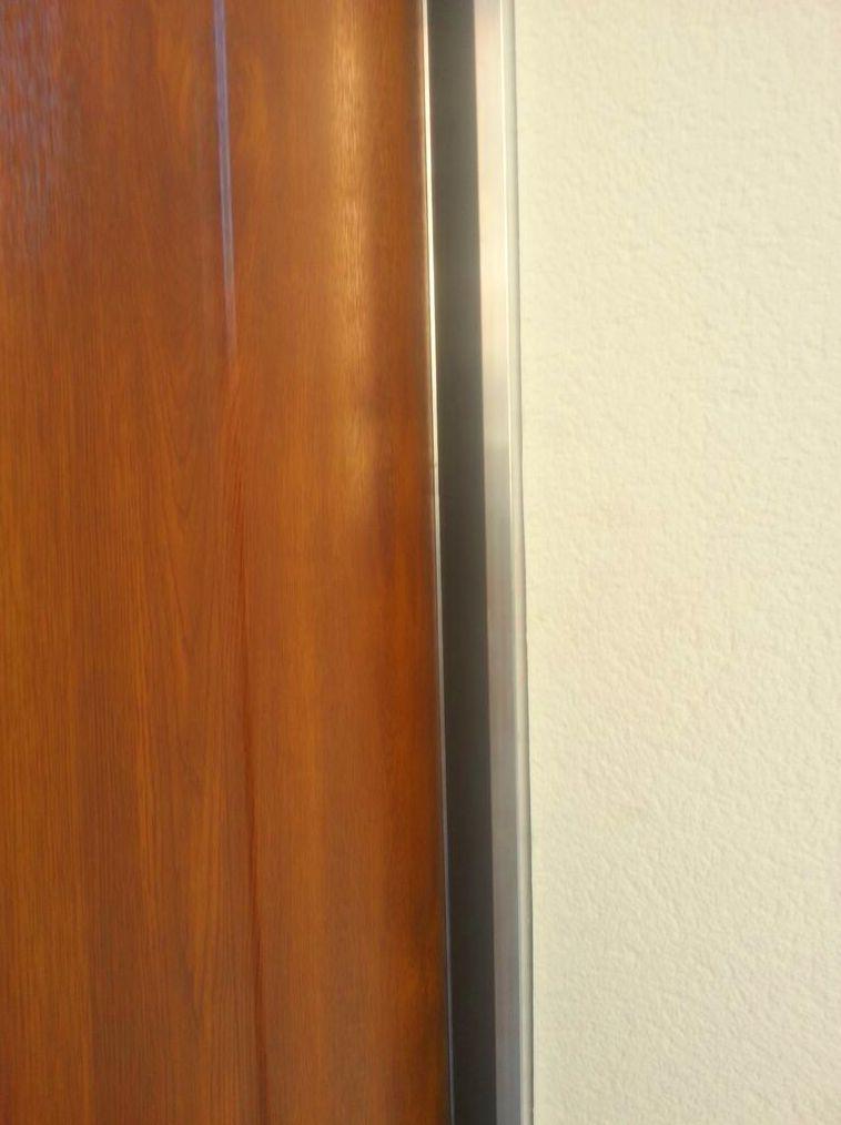 Puerta de garaje corredera lateral seccional perfil de solape