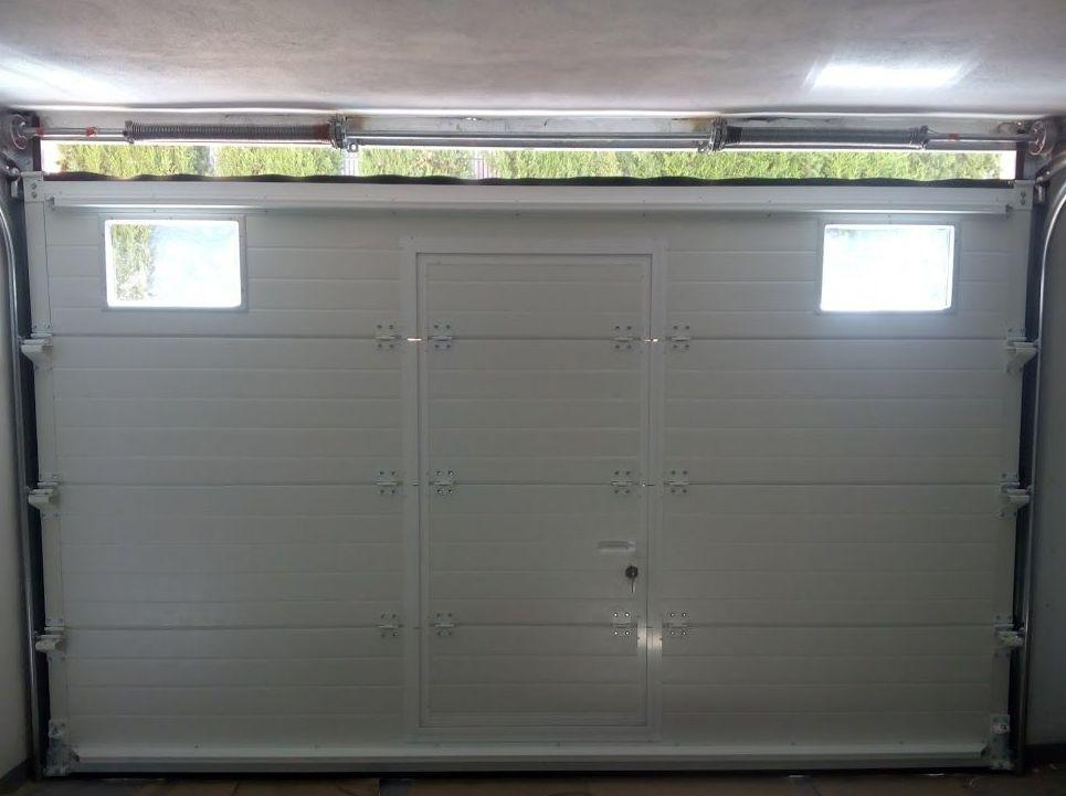 Puerta seccional dintel reducído para instalación