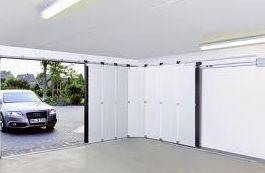 Puerta corredera Seccional de apertura lateral