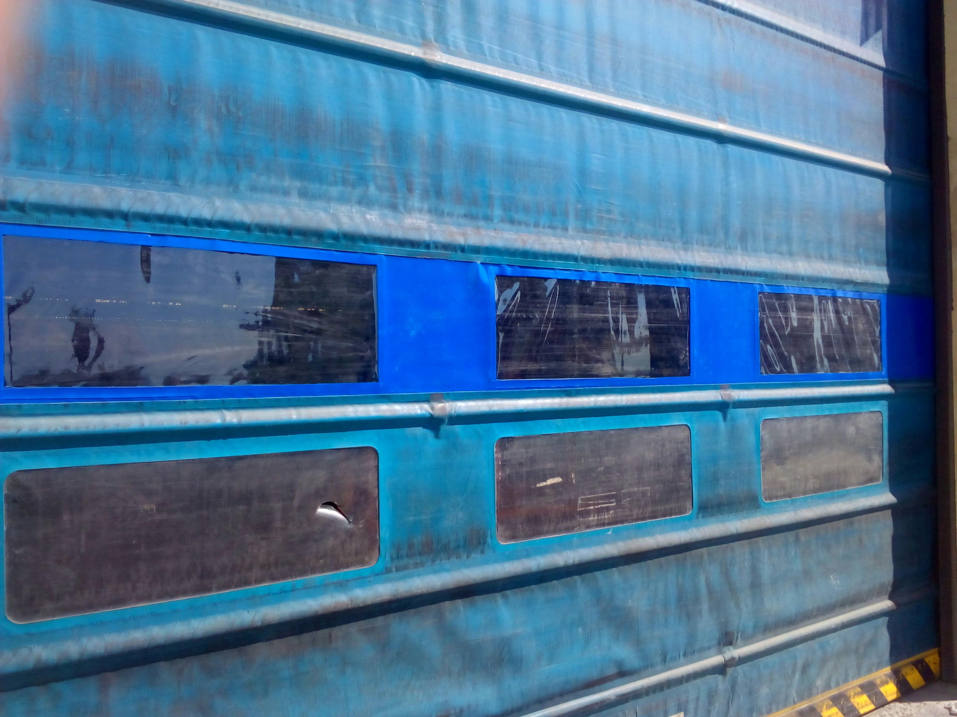 Sustitución de fila de mirillas de puerta rápida de lona de pvc