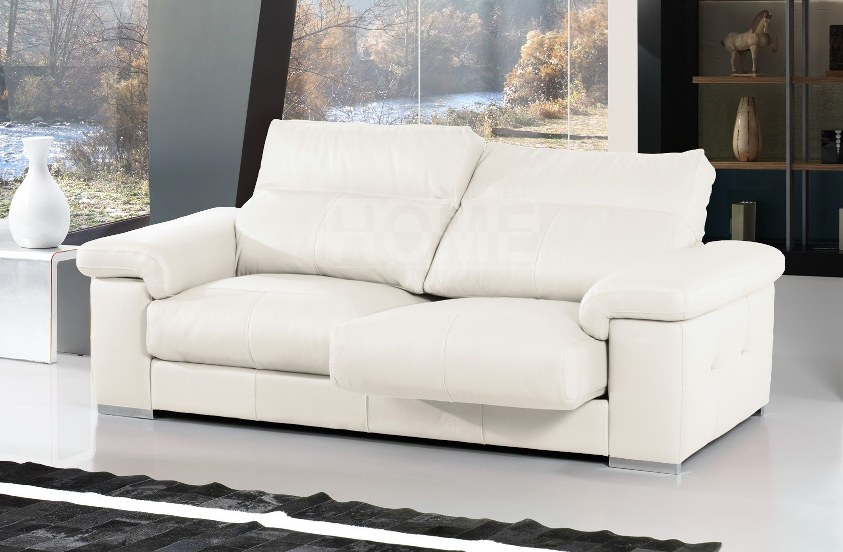 Sofá en piel blanca